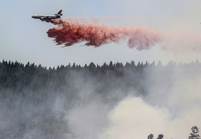A plane drops fire retardant as firefighters battle a blaze in El Portal, Calif., near Yosemite National Park on Tuesday, July 29, 2014. Firefighters in the state are also battling another wildfire in the Sierra Nevada foothills east of Sacramento. (Al Golub / Fr149129 Ap)