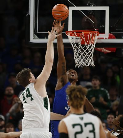 Portland State's Ryan Edwards takes a shot while being defended by Duke's Wendell Carter Jr. on Thursday at the PK80. (Timothy J. Gonzelez / Associated Press)