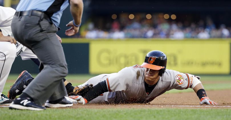 Baltimore's Manny Machado is thrown out trying to stretch a single into a double on Thursday in Seattle. (Elaine Thompson / Associated Press)