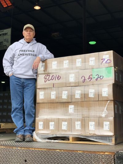 Mike Bowen, Vice President of Prestige Ameritech, stands with a truck load of masks to be sent to MD Anderson Cancer Center. (Elizabeth Givens / Elizabeth Givens)