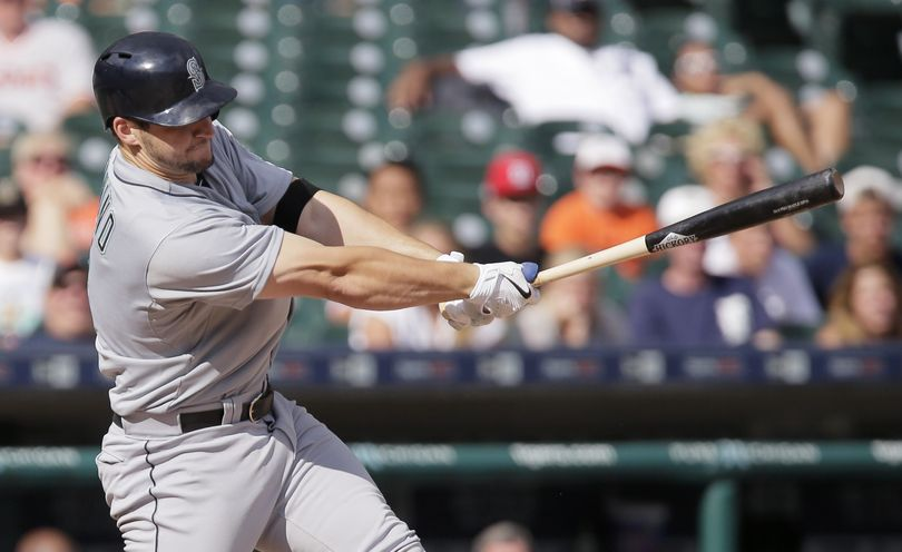Mariners catcher Mike Zunino rips a double to left field to score Chris Taylor and put Seattle ahead in the 12th inning. (Associated Press)
