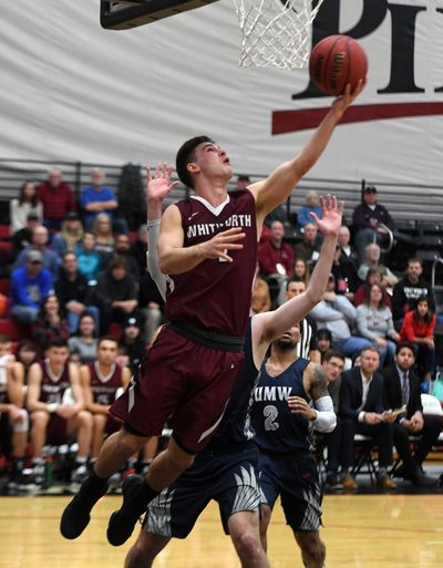 Whitworth guard Ben College (4) shoots an under-handed layup during the second half of a college basketball game, Mon., Dec. 16, 2019, at Whitworth University. (Colin Mulvany / The Spokesman-Review)