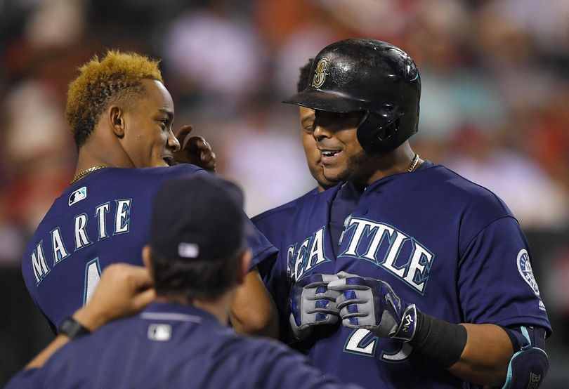 Nelson Cruz, right, brings the power to the Mariners lineup. (Mark J. Terrill / Associated Press)