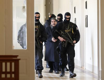 Policemen escort Salih Muslim, former co-chair of the Democratic Union Party, or PYD, to a court room for a custody hearing in Prague, Czech Republic, Tuesday, Feb. 27, 2018. (Petr David Josek / Associated Press)
