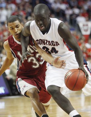 Gonzaga's Bol Kong, right, drives up the court covered by Loyola Marymount's Larry Davis during the first half of an NCAA college basketball game at the West Coast Conference tournament Sunday, March 7, 2010, in Las Vegas. (Isaac Brekken / Fr159466 Ap)