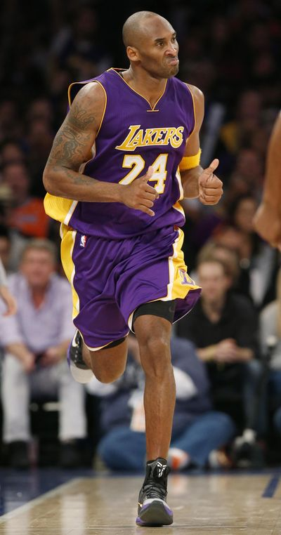 Los Angeles Lakers forward Kobe Bryant runs down court after scoring in the second half of an NBA basketball game against the New York Knicks at Madison Square Garden on Sunday in what might have been his last appearance as a player in the Garden. (Kathy Willens / AP)