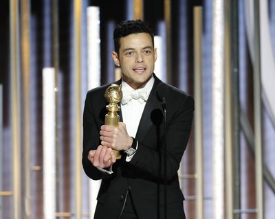 "This image released by NBC shows Rami Malek accepting the award for best actor in a motion picture drama for his role as Freddie Mercury in a scene from ""Bohemian Rhapsody"" during the 76th Annual Golden Globe Awards at the Beverly Hilton Hotel on Sunday, Jan. 6, 2019, in Beverly Hills, Calif. (Paul Drinkwater / Associated Press)"