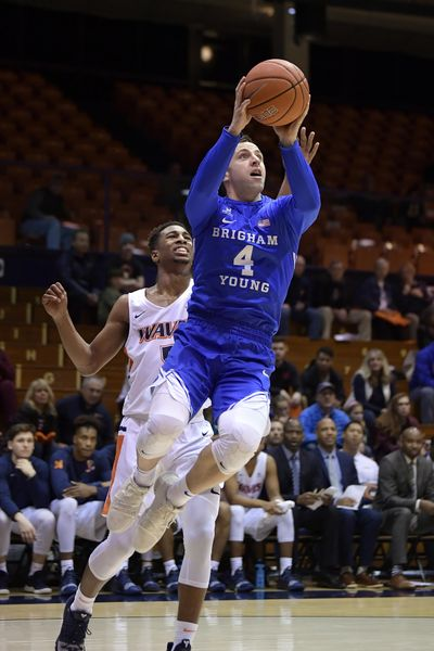 In this Jan. 17, 2019 photo, BYU guard Nick Emery, right, shoots as Pepperdine guard Jade' Smith defends during the first half of an NCAA college basketball game, in Malibu, Calif. BYU guard Nick Emery said Tuesday, July 23, 2019, he is retiring from basketball following a college career that began with high expectations but that ended with him at the center of an NCAA investigation. Emery used social media to announce he is stepping away with a year of eligibility still remaining. (Mark J. Terrill / Associated Press)