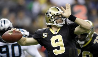 Drew Brees is the second player to pass for more than 5,00 yards in a season. (Associated Press / The Spokesman-Review)