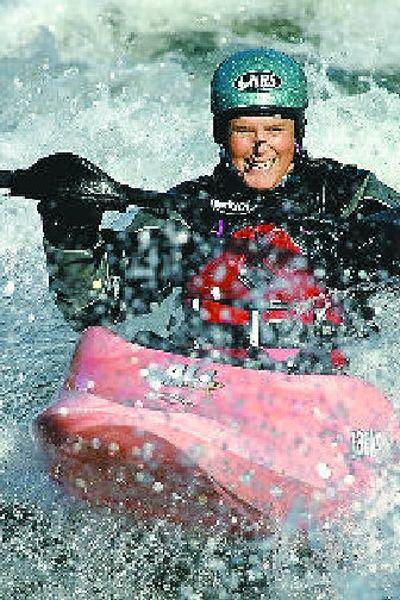 Devon Barker surfs Spokane's Corbin Park swells.  (The Spokesman-Review)