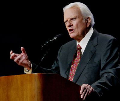 In this June 12, 2003,  photo, the Rev. Billy Graham preaches in Oklahoma City, Okla. Graham, who died Wednesday, Feb. 21, 2018, at his home in North Carolina's mountains at age 99, reached hundreds of millions of listeners around the world with his rallies and his pioneering use of television. (Sue Ograocki / Associated Press)