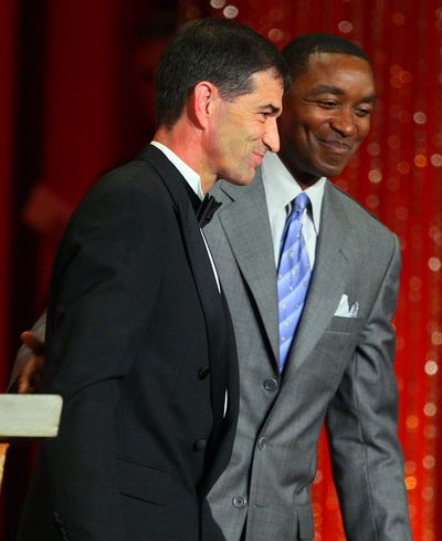 Stockton and his presenter, Hall of Famer Isiah Thomas, leave the stage after Stockton's speech.   (Associated Press / The Spokesman-Review)