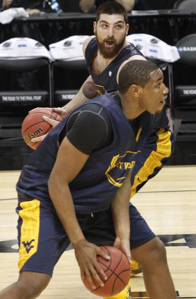 West Virginia's formidable Kevin Jones, bottom, and Deniz Kilicli go through drills on Wednesday. (Associated Press)