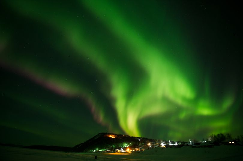 In this Friday, March 9, 2012 photo, an aurora borealis swirls in the sky over the Yukon River village of Ruby, Alaska, a checkpoint of the Iditarod Trail Sled Dog Race. (Marc Lester / Anchorage Daily News)