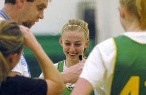 Camille Reynolds, center, a junior point guard at Lakeland High School has averaged just under 12 points per game this season, one less than last year.  (Kathy Plonka / The Spokesman-Review)