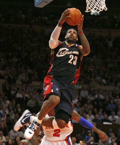 LeBron James goes up for two of his easier points in a 52-point night.  (Associated Press / The Spokesman-Review)