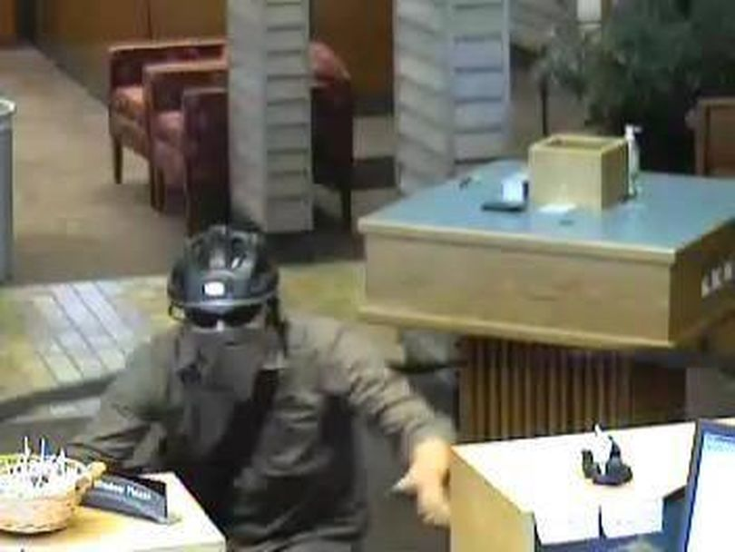 A gunman robbed the Wells Fargo Bank at 114 E. Appleway in Coeur d'Alene Friday about 6 p.m., then escaped on a bicycle. Anyone with information is asked to call Coeur d'Alene police at (208) 769-2320 or the FBI at (208) 664-5128. Investigators do not believe the robbery is related to a series of bank robberies in Spokane that have been attributed to a man who typically escapes on a bike.  (Coeur d'Alene Police Department)