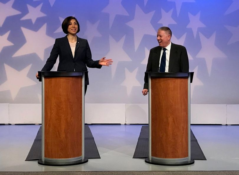 Paulette Jordan, left, and A.J. Balukoff, right, debate during the
