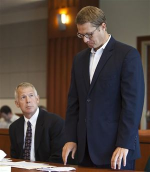 Former Idaho State Senator John McGee, right, appears in court at the Ada County Courthouse in Boise with attorney Scott McKay, Tuesday, Aug. 21, 2012. (AP/Idaho Statesman / Darin Oswald)