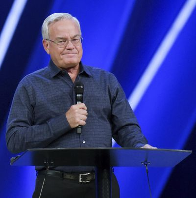 Willow Creek Community Church Senior Pastor Bill Hybels stands before his congregation, Tuesday, April 10, 2018, in South Barrington, Ill., where he announced his early retirement effective immediately, amid a cloud of misconduct allegations involving women in his congregation. (Mark Black / Associated Press)