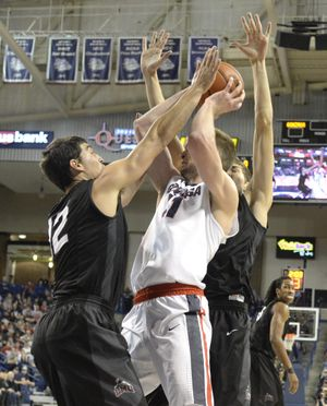 Gonzaga's Domantas Sabonis, right, struggles in the doubleteam of Loyola Marymount's Steve Haney, left, and Marin Mornar, right, Wednesday, Dec. 23, 2015 at McCarthey Athletic Center at Gonzaga University. Gonzaga cruised to 85-62 victory. (Jesse Tinsley / The Spokesman-Review)