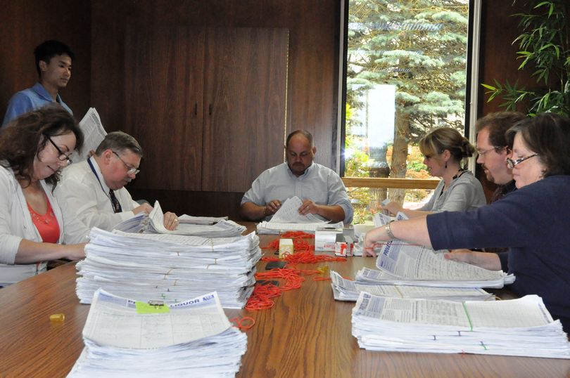 Staff for the Secretary of State's elections office begin counting petitions for I-1100 turned in June 23, 2010. (Jim Camden/Spokesman-Review)