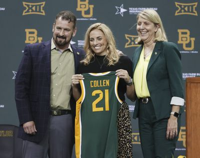 Nicki Collen, center, holds up a jersey while bring introduced as the new Baylor women's head basketball coach by school president Linda Livingstone, right, and athletic director Mack Rhoades, left, Wednesday, May 5, 2021, in Waco, Texas.  (Associated Press)