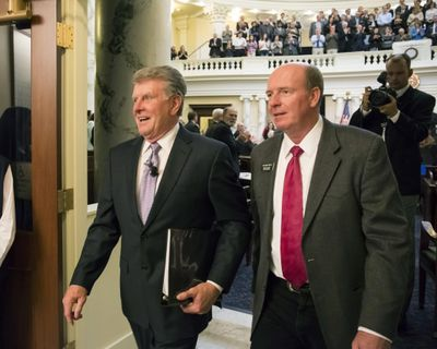 Idaho Gov. Butch Otter, left, leaves the House chambers with House Majority Leader Mike Moyle, R-Star, after delivering his State of the State address Jan. 11, 2016 at the state Capitol building in Boise. (Otto Kitsinger / Associated Press)