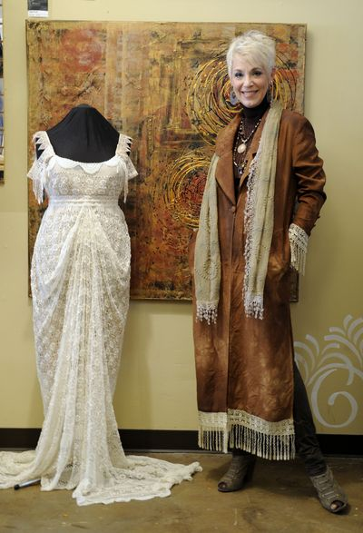 "Lynne Blackwood is a clothing and accessory designer who also paints and occasionally performs, walking on the catwalk or in a local commercial. For the wedding gown pictured, Blackwood used vintage lace and repurposed materials in her design. Her mixed media painting is titled ""Lava Flow."" (Colin Mulvany)"