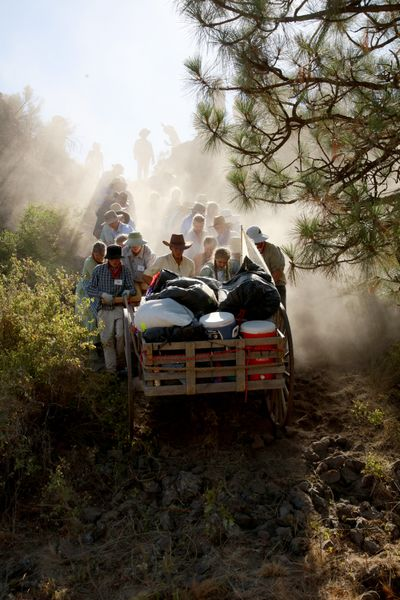 A handcart company, assisted by George Ditto (in cowboy hat), lowers a handcart down a steep cliff during a recent pioneer trek.  (Courtesy of Mindy Hymas)