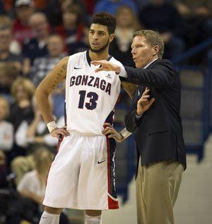 Gonzaga coach Mark Few surveys the situation with Josh Perkins. (Colin Mulvany)