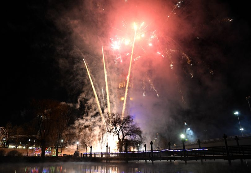 Fireworks explode above the riverfront Park clock Tower Thursday, January 1, 2015. Thousands flocked to the downtown festivities at First Night Spokane. JESSE TINSLEY jesset@spokesman.com (Jesse Tinsley / The Spokesman-Review)