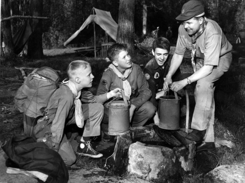 S-R Archive find of the day: In this 1952 photo, Dexter Rowell, John Forehand and David Raymond stop at a spring during a camporee with District Scout Executive Frank Fix . (The Spokesman-Review Photo Archi)