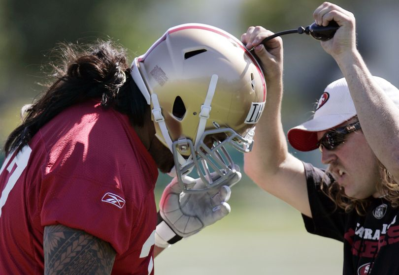 San Francisco 49ers guard Mike Iupati, a first-round draft pick from Idaho, is helped with his helmet during rookie football mini-camp at 49ers headquarters in Santa Clara, Calif., Friday, April 30, 2010. (Paul Sakuma / Associated Press)