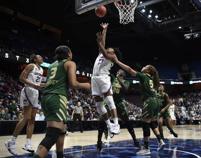 Connecticut's Christyn Williams makes a basket as South Florida's Elena Tsineke, right, defends during the first half of March 8, 2020 NCAA college basketball game in at Mohegan Sun Arena in Uncasville, Conn.  (Associated Press)