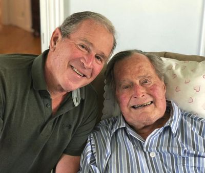 In this photo provided by the Office of George W. Bush, former U.S. presidents George H.W. Bush and his son pose for a photo in Kennebunkport, Maine, Tuesday, June 12, 2018. (Associated Press)