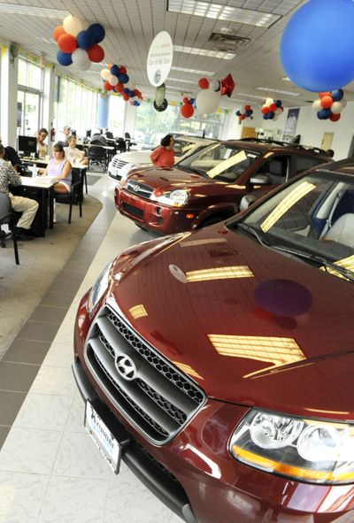 People shop for cars at Hyundai Village in Danvers, Mass. Korean automaker Hyundai and its affiliate Kia bested Chrysler in the U.S. market in August, selling 100,665 vehicles.  (File Associated Press / The Spokesman-Review)