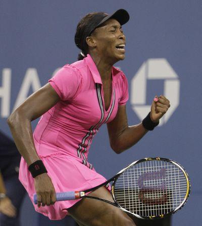 Venus Williams reacts after defeating Magdalena Rybarikova.  (Associated Press / The Spokesman-Review)