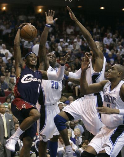 The Orlando Magic clamped down on the Cleveland Cavaliers.  (Associated Press / The Spokesman-Review)