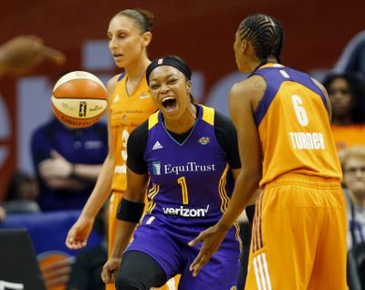 Los Angeles Sparks guard Odyssey Sims (center) celebrates a basket against the Phoenix Mercury in the second quarter of a WNBA semifinals game in Phoenix on Sunday. (Associated Press)