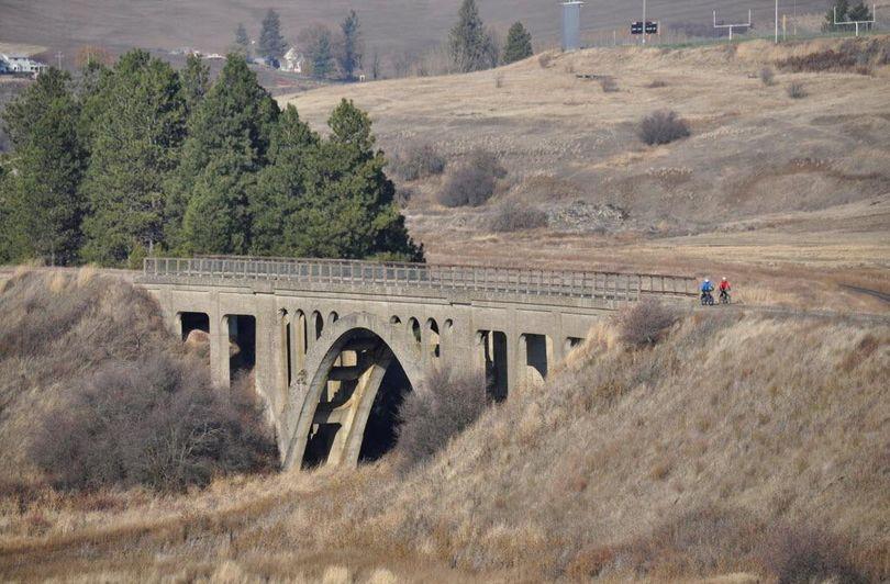 Cyclists cross a century-old trestle near Rosalia on the John Wayne Trail, which runs 253 miles across Washington. (Rich Landers / The Spokesman-Review)