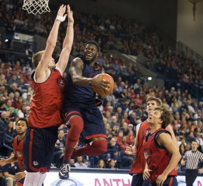 Gonzaga's Gary Bell, Jr. beats teammate Domantas Sabonis to the basket in the McCarthey Athletic Center during Kraziness in the Kennel. (Dan Pelle)