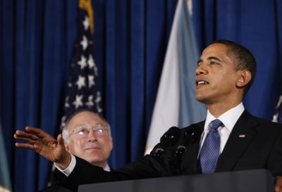 Interior Secretary Ken Salazar looks on as President Barack Obama delivers remarks at the Interior Department  on Tuesday.  (Associated Press / The Spokesman-Review)