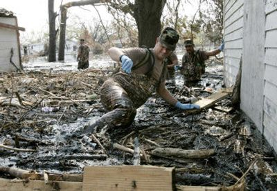 New Mexico Army National Guard Sgt. 1st Class Chris Andrews pushes through debris during a house to house search in Port Sulphur, La., on Saturday.   (Erich Schlegel/ Dallas Morning News / The Spokesman-Review)
