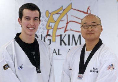 Jung Kim, right, shown with his head instructor, Justin Howard, has opened a martial arts studio that teaches tae kwon do. (J. BART RAYNIAK / The Spokesman-Review)
