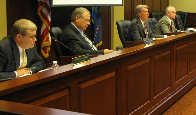 From left, Idaho Attorney General Lawrence Wasden, Secretary of State Lawerence Denney, Gov. Butch Otter and state Controller Brandon Woolf at Tuesday's state Land Board meeting (Betsy Z. Russell)
