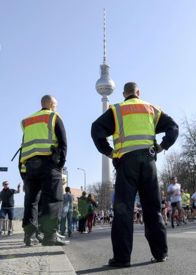 Police guard during the half marathon run in Berlin, Sunday, April 8, 2018. (Christophe Gateau / Associated Press)