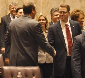 OLYMPIA -- Rep. Matt Shea, R-Spokane Valley, shakes hands with Rep. Marcus Riccelli, D-Spokane, as lawmakers file into the House of Representatives Monday for the start of the 2016 session (Jim Camden/The Spokesman-Review)