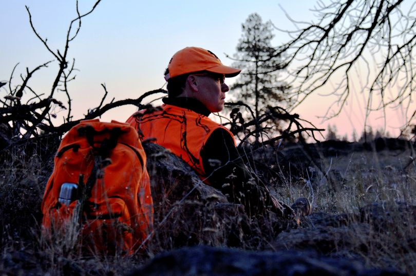 A deer hunter waits for shooting time on opening day in Eastern Washington. (Rich Landers)