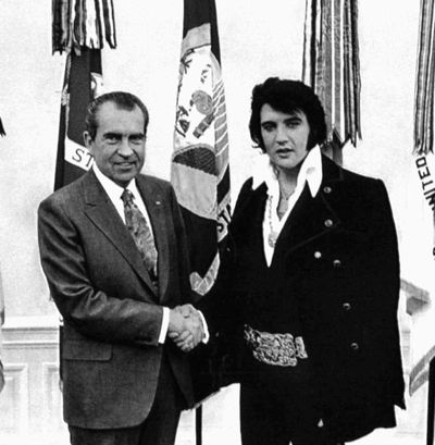 President Richard Nixon  and Elvis Presley shake hands in the White House on Dec. 21, 1970.  Memos concerning Presley's visit have been posted on the FBI's Web page.  (File Associated Press)
